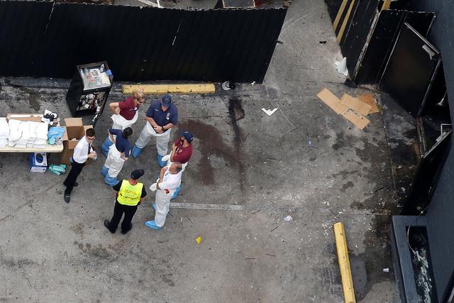 Investigators work the scene following a mass shooting at the Pulse gay nightclub in Orlando Florida, U.S. June 12, 2016. (Carlo Allegri/Reuters)