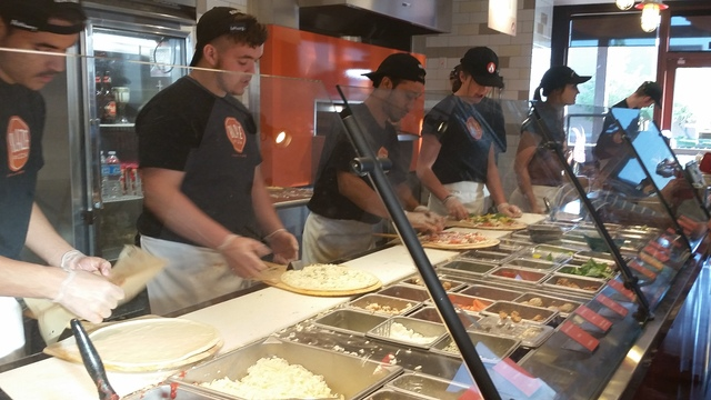 Blaze Pizza staff members assemble custom pies at the Henderson restaurant, 10520 S. Eastern Ave. (Lisa Valentine/View)
