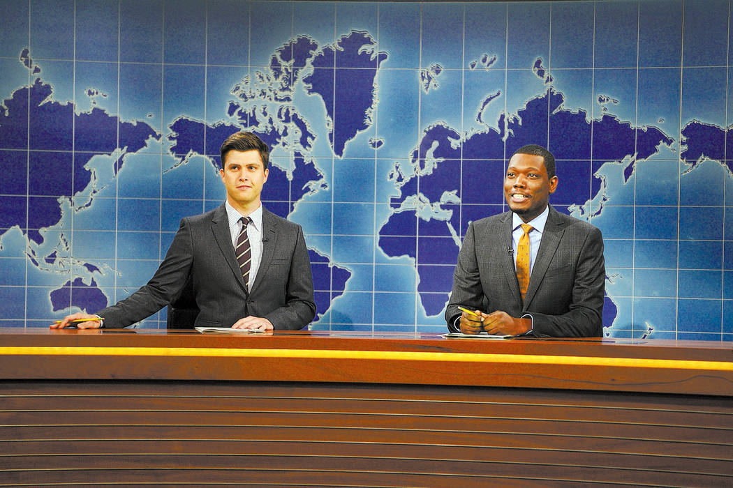 "Colin Jost and Michael Che are seen during the ""Weekend Update"" skit on September 27, 2014 (Dana Edelson/NBC)"