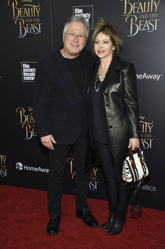 "Composer Alan Menken and his wife Janis Menken attend a special screening of Disney's ""Beauty and the Beast"" at Alice Tully Hall on Monday, March 13, 2017, in New York. (Evan Agostini/Invision/AP)"