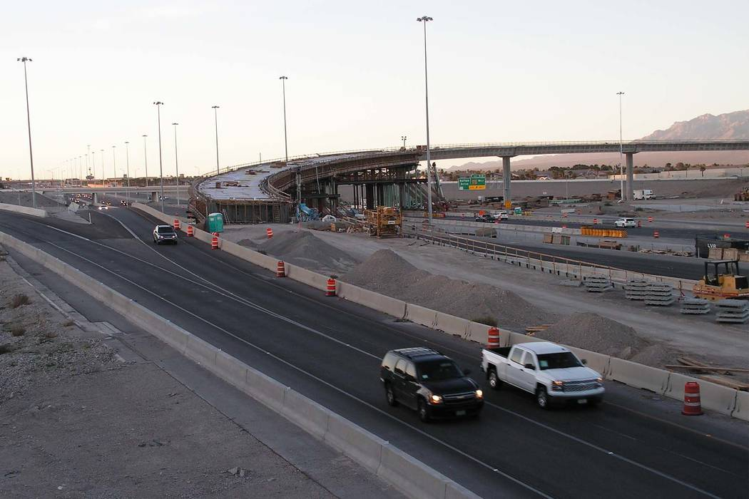 Vehicles travel south on U.S. Highway 95 through construction at the Centennial Bowl, an interchange under construction at the northern I-215 beltway in Las Vegas on Monday, March 13, 2017. (Greg  ...
