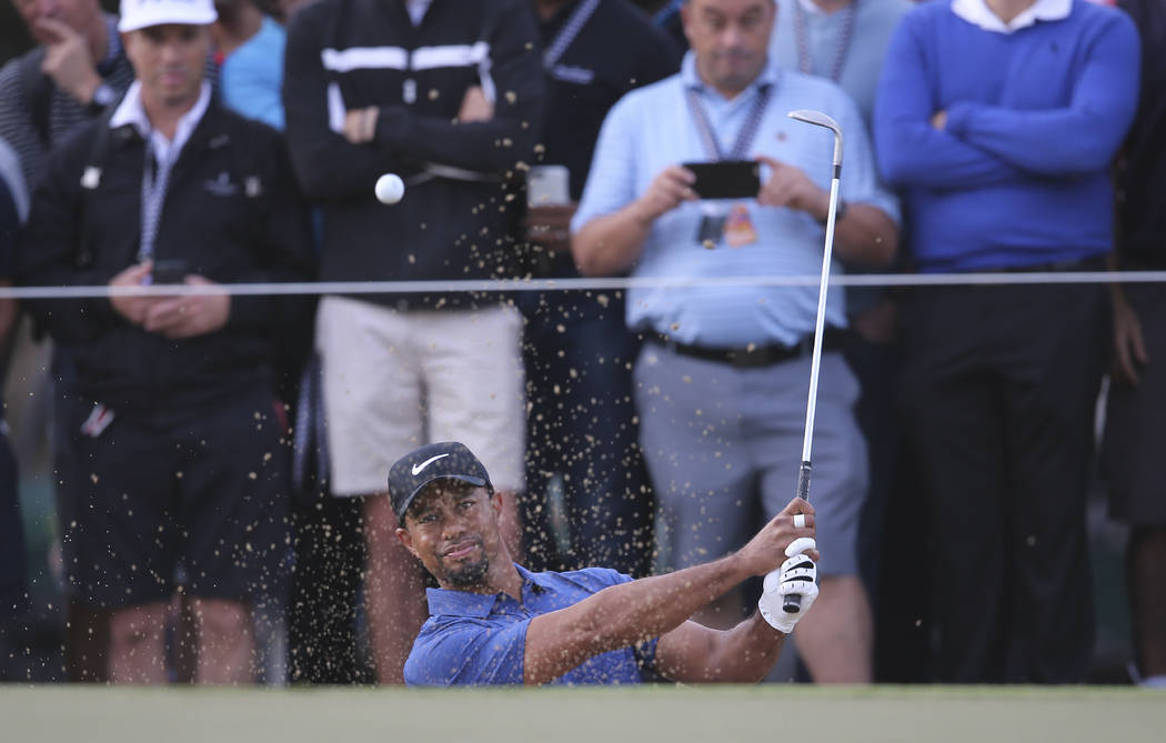 Tiger Woods plays a bunker shot on the 10th hole during the 1st round of the Dubai Desert Classic golf tournament in Dubai, United Arab Emirates, Thursday, Feb. 2, 2017. (AP Photo/Kamran Jebreili)