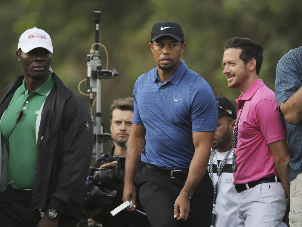 In this Thursday, Feb. 2, 2017 photo, Tiger Woods walking to hole 11th tee shot during the 1st round of the Dubai Desert Classic golf tournament in Dubai, United Arab Emirates. Woods has withdrawn ...
