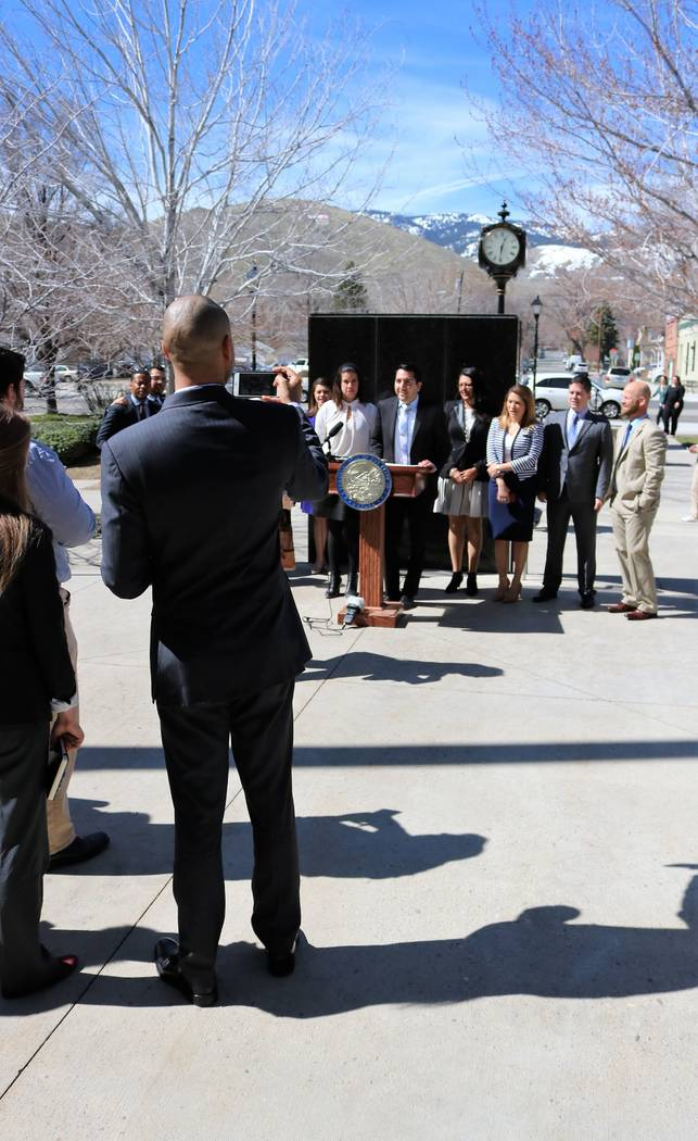 Sen. Majority Leader Aaron Ford, D-Las Vegas documents the announcement of the creation of the Nevada Future Democratic Caucus, comprised of Democrat legislators under 40, March 14, 2017. (Victor  ...