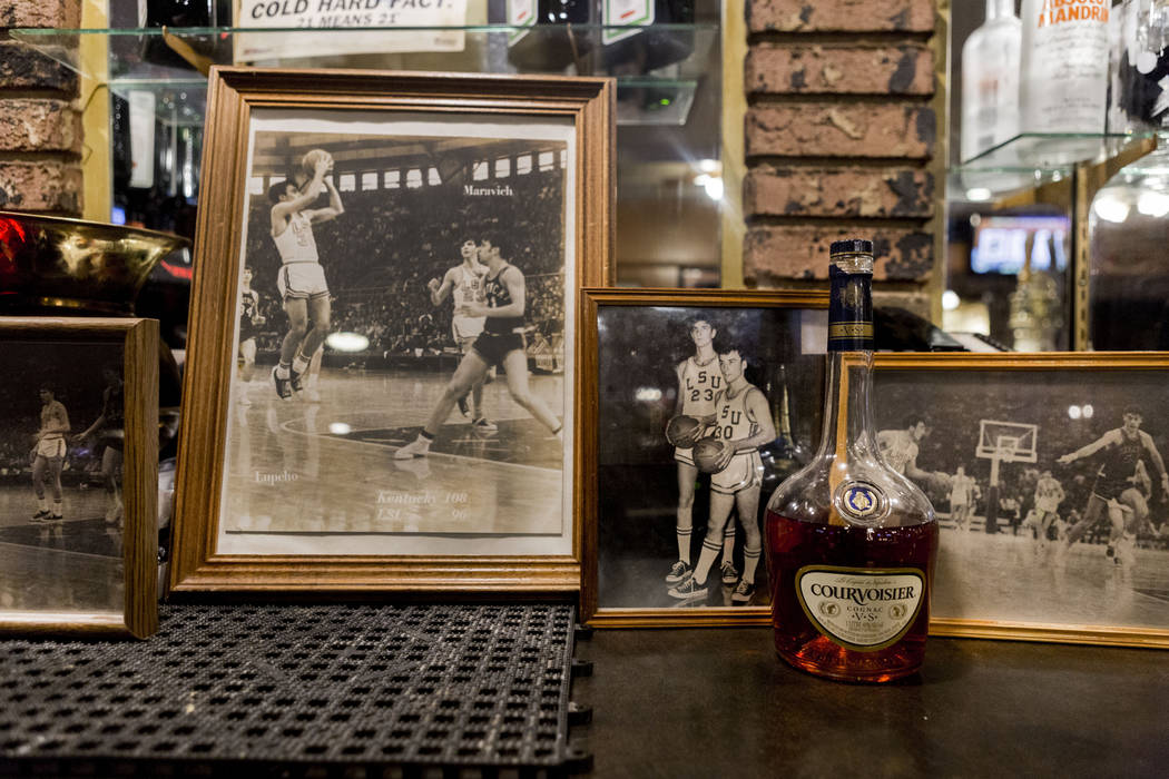 """Some 1960ճ photographs of Rich Lupcho and his teammate """"Pistol"""" Pete Maravich at Louisiana State are displayed, Wednesday, March 15, 2017, at the Tap House on West Charlest ..."""