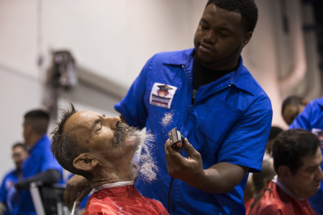 Veteran David Czonka gets his beard shaved off by Masterpiece Barber School student Deyon Christie during the 13th annual U.S. Vets-Las Vegas Stand Down event at the Cashman Center, Wednesday, Mar ...