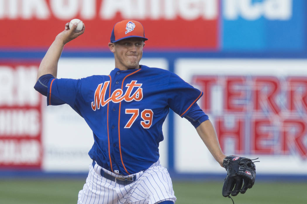New York Mets starting pitcher Paul Sewald, (79), a Las Vegas native, delivers to the plate during the first of a two-game spring training rematch of the 2015 National League Championship series,  ...