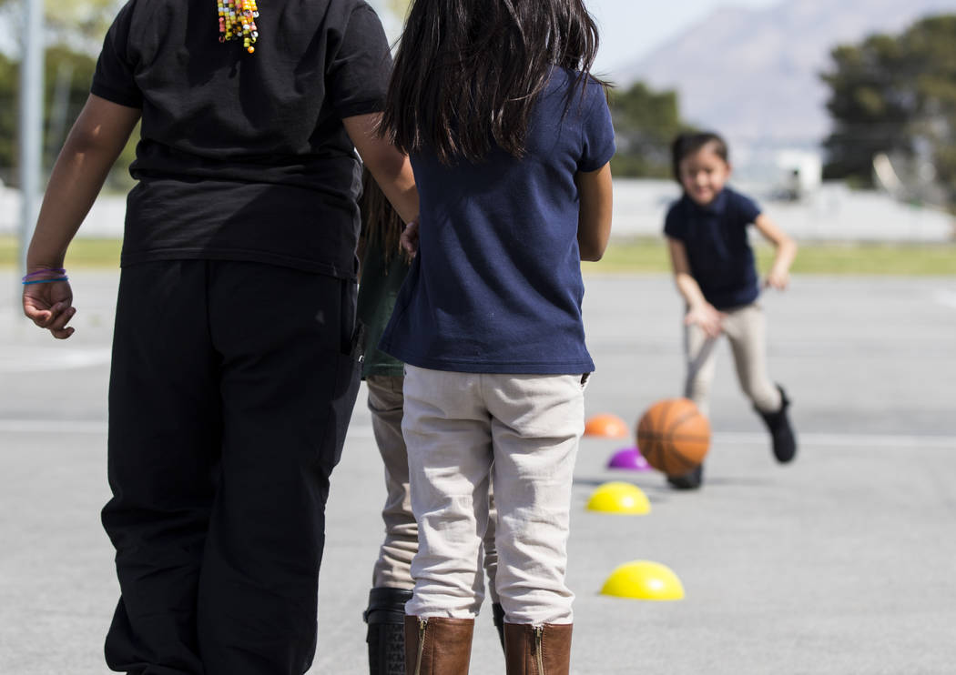 Children participate in a physical education class at Kit Carson Elementary School in Las Vegas on Wednesday, March 15, 2017. (Miranda Alam/Las Vegas Review-Journal) @miranda_alam