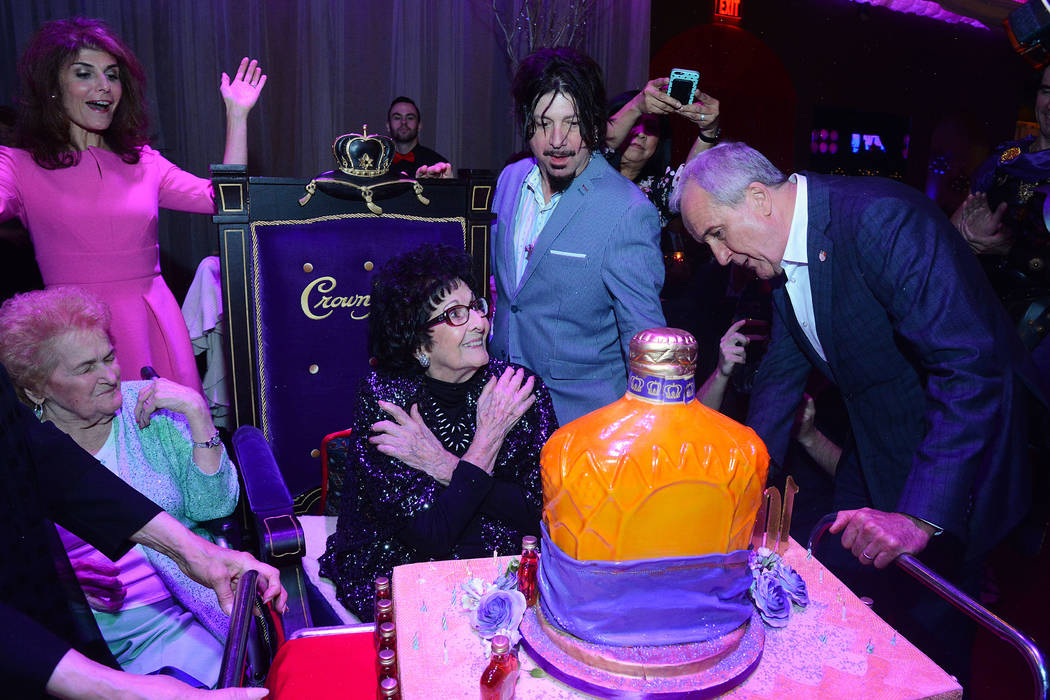 """Mama Maria"" Perry is presented with an oversized bottle of Crown Royal by her nephew Larry Ruvo during her 100th birthday at Copa Room at the Bootlegger Bistro on  Monday, March 13, 2017. Standin ..."