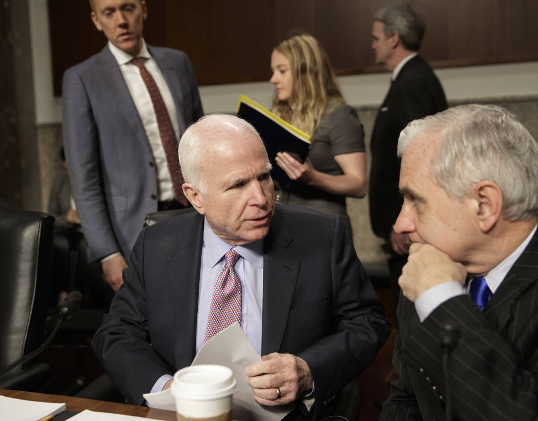 Senate Armed Services Committee Chairman Sen. John McCain, R-Ariz., left, confers with the committee's ranking member, Sen. Jack Reed, D-R.I., on Capitol Hill in Washington, Tuesday, March, 14, 20 ...