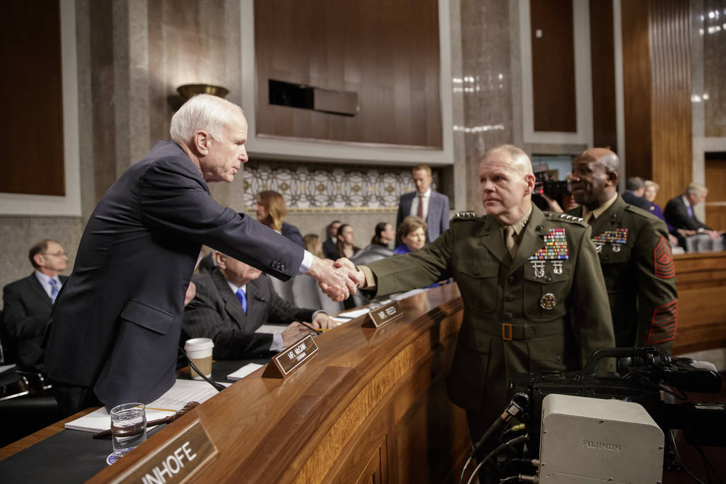Senate Armed Services Committee Chairman Sen. John McCain, R-Ariz., left, welcomes Marine Corps Commandant Gen. Robert B. Neller, center, and Sgt. Major of the Marine Corps Ronald L. Green on Capi ...