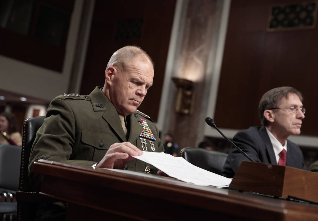 Marine Corps Commandant Gen. Robert B. Neller, left, and Acting Navy Secretary Sean J. Stackley, wait to testify on Capitol Hill in Washington, Tuesday, March, 14, 2017, before the Senate Armed Se ...