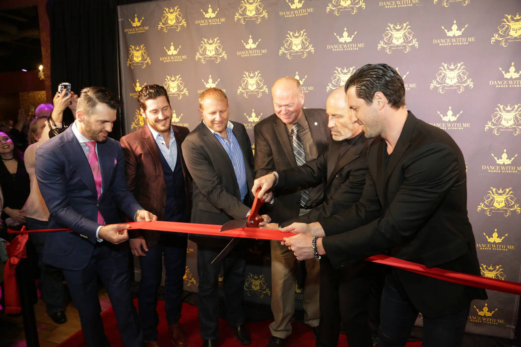 Tony Dovolani, Valentin Chmerkovskiy, Maksim Chmerkovskiy, right, and others celebrate the grand opening of their dance studio Dance With Me at Tivoli Village on Thursday, March 9, 2017, in Las Ve ...