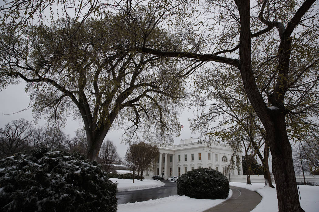 Snow covers the ground outside of the White House in Washington, Tuesday, March 14, 2017. (AP Photo/Evan Vucci)