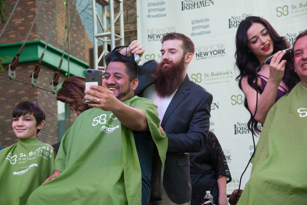 """Absinthe"" cast members Billy and Emily England participate in St. Baldrick's Day at New York-New York on Saturday, March 11, 2017, in Las Vegas. (Courtesy)"