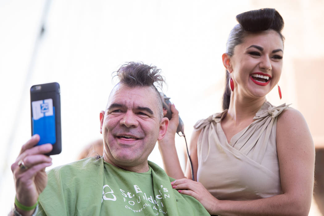 John Katsilometes and Melody Sweets participate in St. Baldrick's Day at New York-New York on Saturday, March 11, 2017, in Las Vegas. (Courtesy)