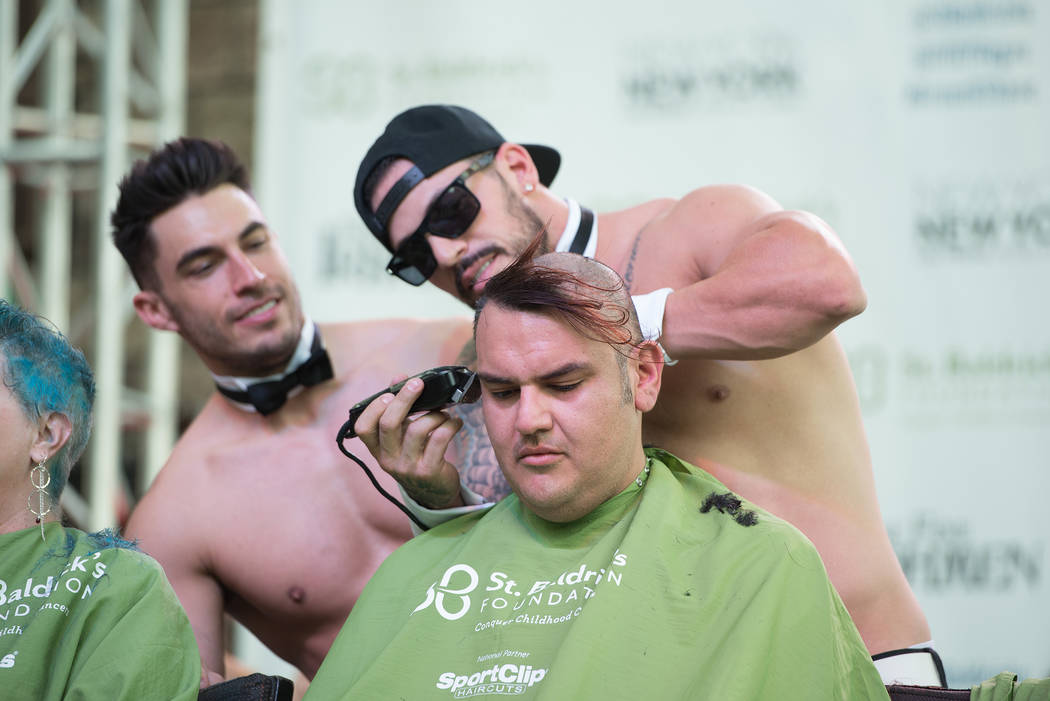 Jon Howes and Mikey Perez of Chippendales at The Rio participate in St. Baldrick's Day at New York-New York on Saturday, March 11, 2017, in Las Vegas. (Courtesy)
