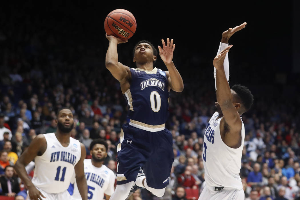 Mount St. Mary's Junior Robinson (0) shoots against New Orleans' Nate Frye (3) in the second half of a First Four game of the NCAA college basketball tournament, Tuesday, March 14, 2017, in Dayton ...