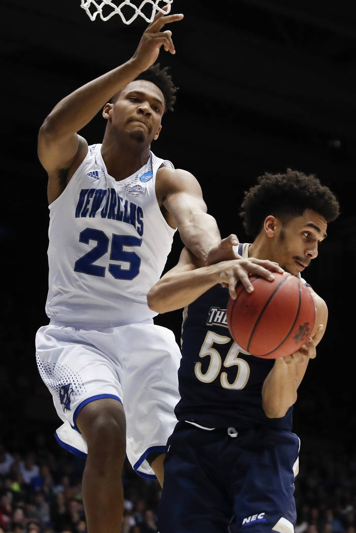 Mount St. Mary's Elijah Long (55) and New Orleans' Travin Thibodeaux (25) battle for a rebound in the second half of a First Four game of the NCAA college basketball tournament, Tuesday, March 14, ...