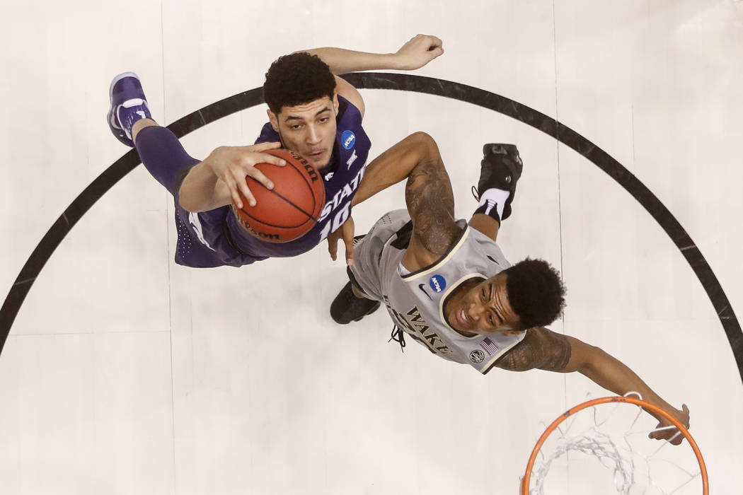 Kansas State's Isaiah Maurice, left, and Wake Forest's John Collins, right, battle for a rebound in the first half of a First Four game of the NCAA college basketball tournament, Tuesday, March 14 ...