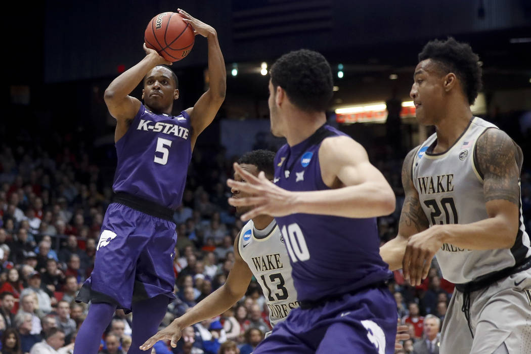 Kansas State's Barry Brown (5) shoots past Wake Forest's Bryant Crawford (13) in the first half of a First Four game of the NCAA college basketball tournament, Tuesday, March 14, 2017, in Dayton,  ...
