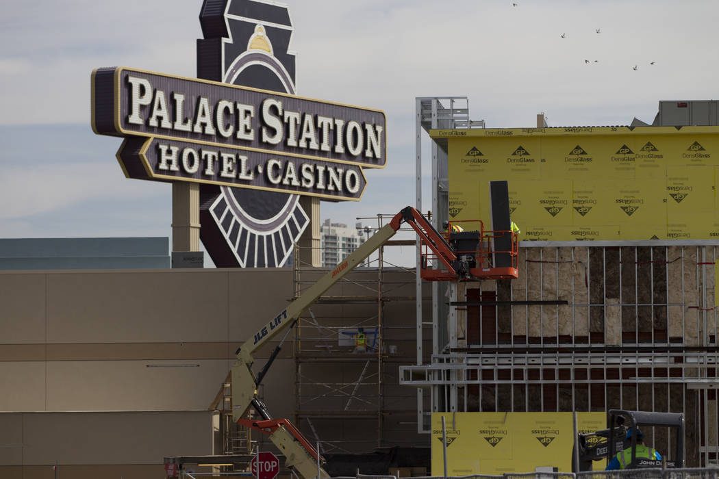 Workers on the side of a building currently under construction at Palace Station hotel-casino on Wednesday, March 15, 2017, in Las Vegas. (Erik Verduzco/Las Vegas Review-Journal) @Erik_Verduzco