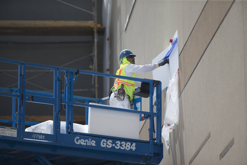 A worker on the side of a building currently under construction at Palace Station hotel-casino on Wednesday, March 15, 2017, in Las Vegas. (Erik Verduzco/Las Vegas Review-Journal) @Erik_Verduzco