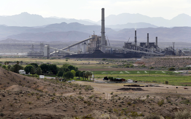 The Reid-Gardner power generating station is seen near a farm on the Moapa Indian Reservation in Moapa, May 14, 2012. (Julie Jacobson/AP)