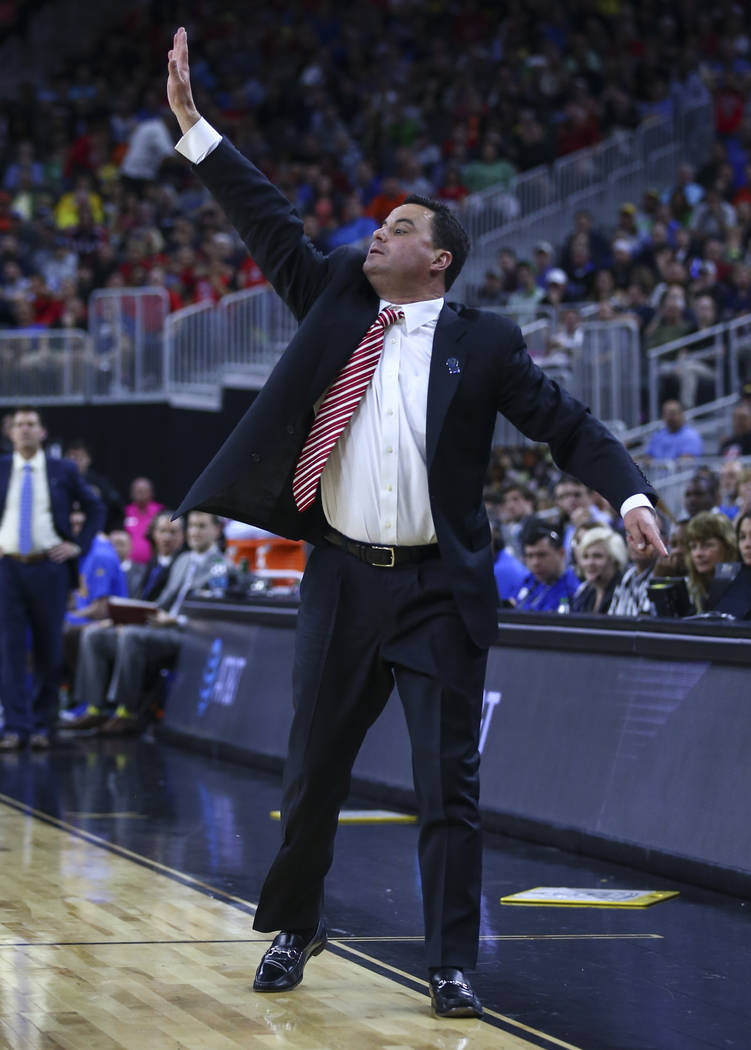 Arizona head coach Sean Miller shouts to his team as they play UCLA during the Pac-12 Conference basketball tournament semifinals at the T-Mobile Arena in Las Vegas on Friday, March 10, 2017. Ariz ...