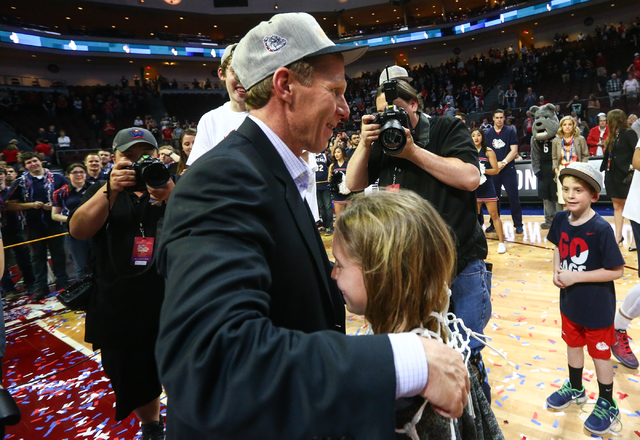 Gonzaga head coach Mark Few puts the net over the head of his daughter, Julia, after his team's 85-75 win over Saint Mary's in the West Coast Conference basketball championship game at the Orleans ...