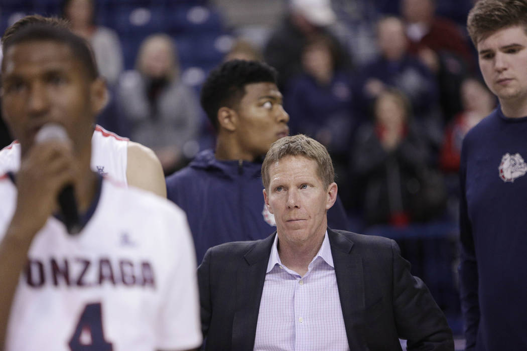 Gonzaga head coach Mark Few, center, looks on during a senior night event after Gonzaga lost an NCAA college basketball game 79-71 to BYU in Spokane, Wash., Saturday, Feb. 25, 2017. (Young Kwak/AP)