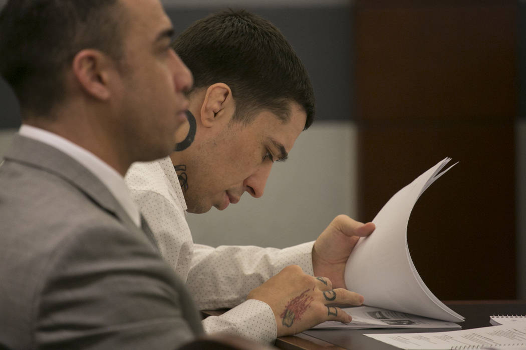 War Machine, also known as Jonathan Koppenhaver, pages through documents prior to closing statements at the Regional Justice Center on Thursday, March 16, 2017, in Las Vegas. (Bridget Bennett/Las  ...