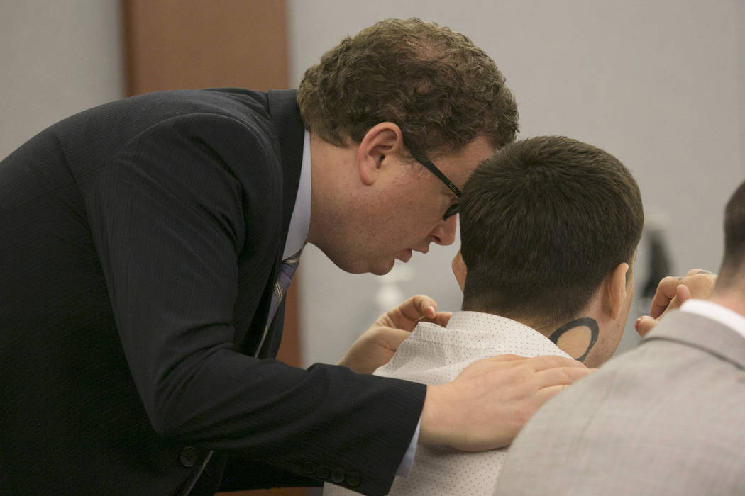 War Machine, also known as Jonathan Koppenhaver, sits while defense attorney Jay Leiderman has a word with him at the Regional Justice Center on Thursday, March 16, 2017, in Las Vegas. (Bridget Be ...