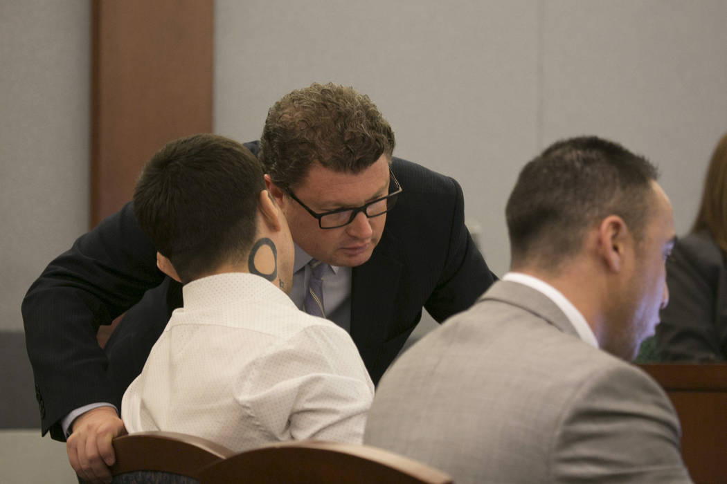 War Machine, also known as Jonathan Koppenhaver, has a word with defense attorney Jay Leiderman at the Regional Justice Center prior to closing statements on Thursday, March 16, 2017, in Las Vegas ...