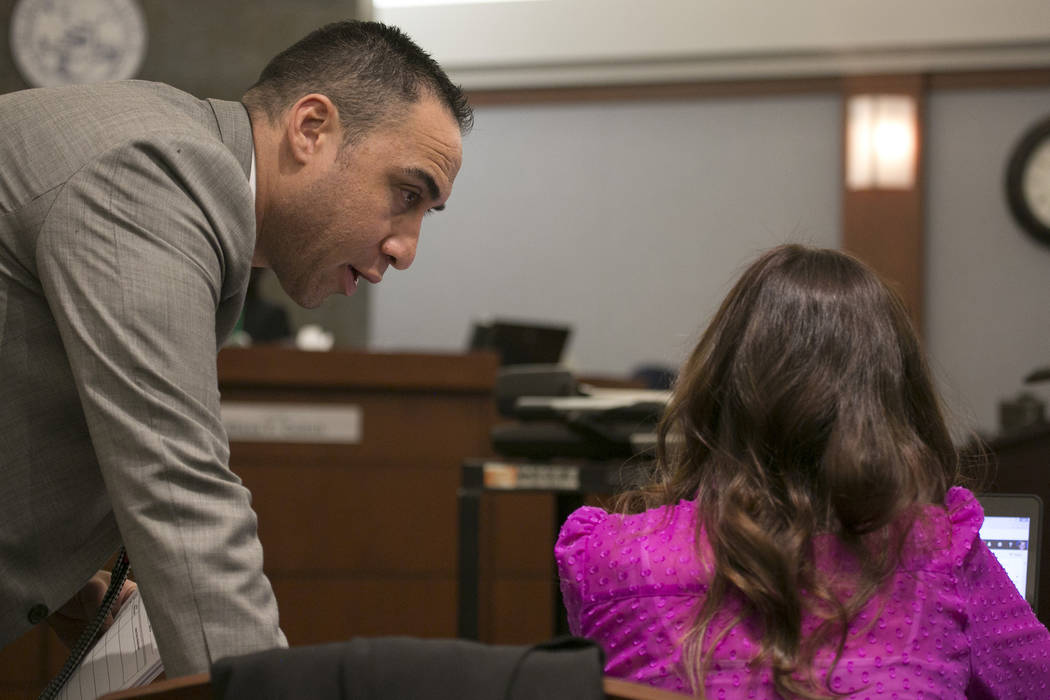 Defense attorney Brandom Sua, left, speaks with Chief Deputy District Attorney Jacqueline Bluth at the Regional Justice Center prior to closing statements on Thursday, March 16, 2017, in Las Vegas ...