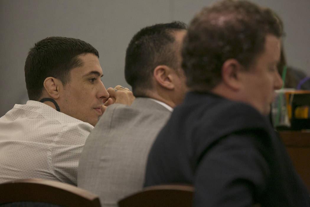War Machine, also known as Jonathan Koppenhaver, left, listens to the prosecutors closing statements at the Regional Justice Center on Thursday, March 16, 2017, in Las Vegas. (Bridget Bennett/Las  ...