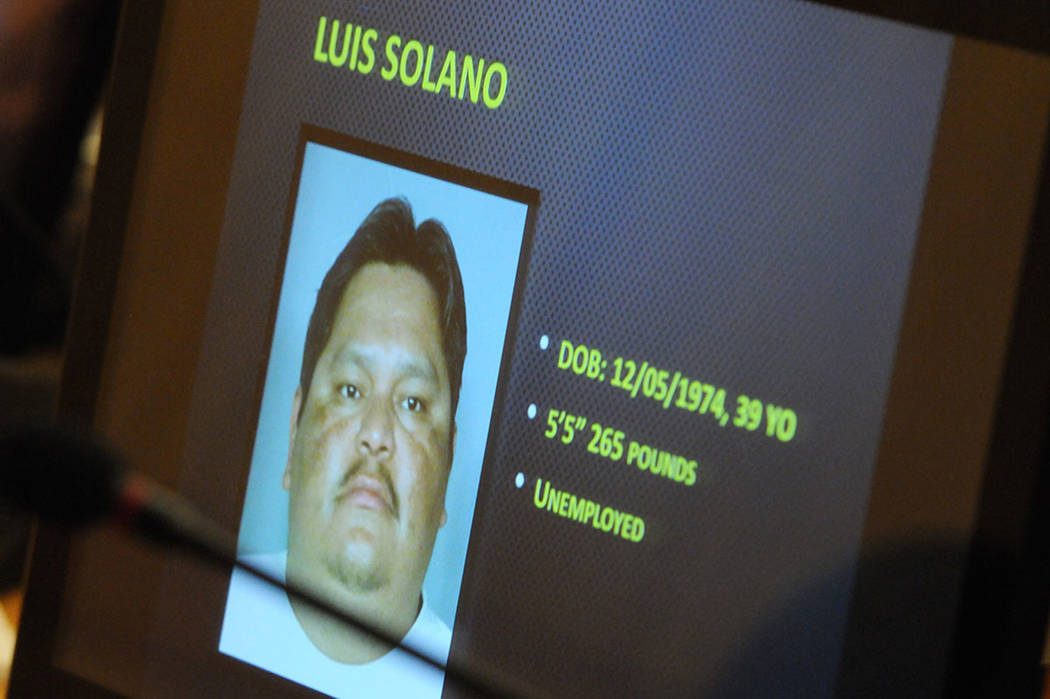 The photo of Luis Solano is displayed on a screen during a public hearing on his death at the Commission Chambers inside the Clark County Government Center in Las Vegas Thursday, Feb. 6, 2014. (Er ...