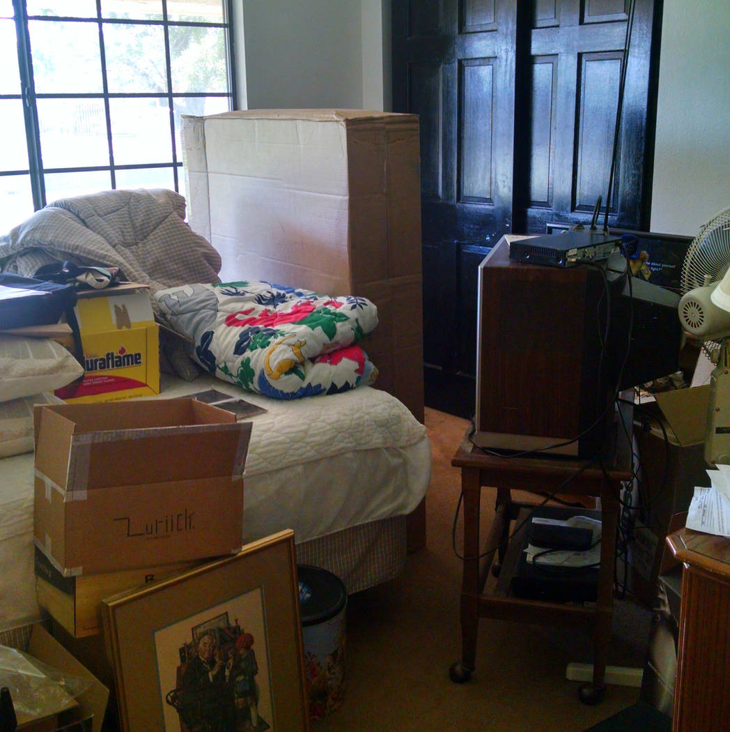 COURTESY LIFE.ORGANIZED Before: This spare bedroom became a catchall for items which didn't have a place in the home.