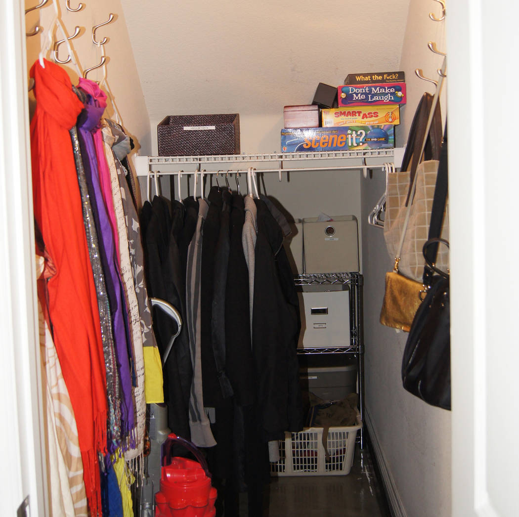 COURTESY LIFE.ORGANIZED After: The addition of shelves and bins keep items off the floor.