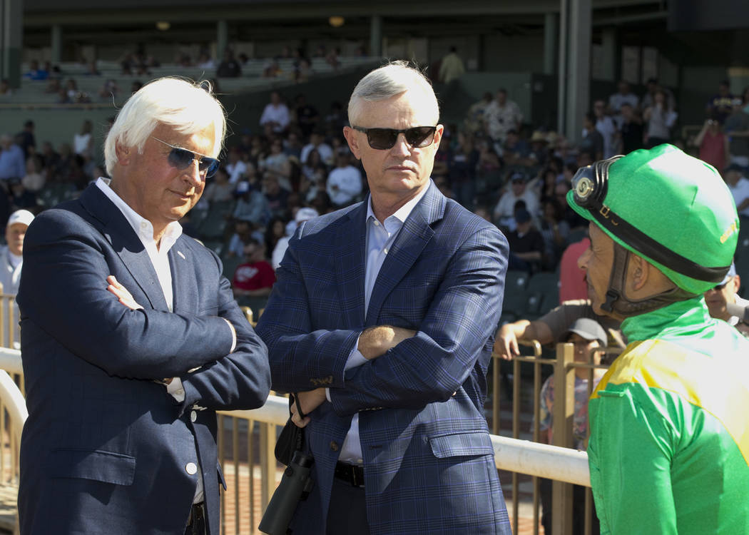 In a photo provided by Benoit Photo, jockey Mike Smith, right, talks with trainer Bob Baffert, left, and owner Everett Dobson after Mastery won the $400,000 San Felipe Stakes horse race Saturday,  ...