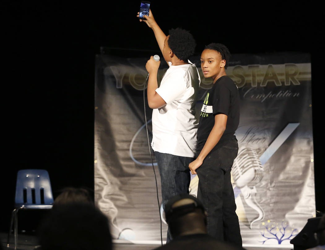 Hosts Dezmone Black, 15, from left, and Jesurun Black, 14, stakes a selfie during the Young Star singing competition at Cheyenne High School on Saturday, March 18, 2017, in Las Vegas. (Christian K ...