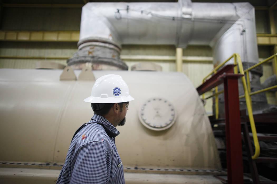 Plant Director Jason Hammons walks near the turbine at the turbine room at the Reid Gardner Generating Station on Thursday, March 16, 2017, in Moapa, Nev. (Rachel Aston/Las Vegas Review-Journal) @ ...