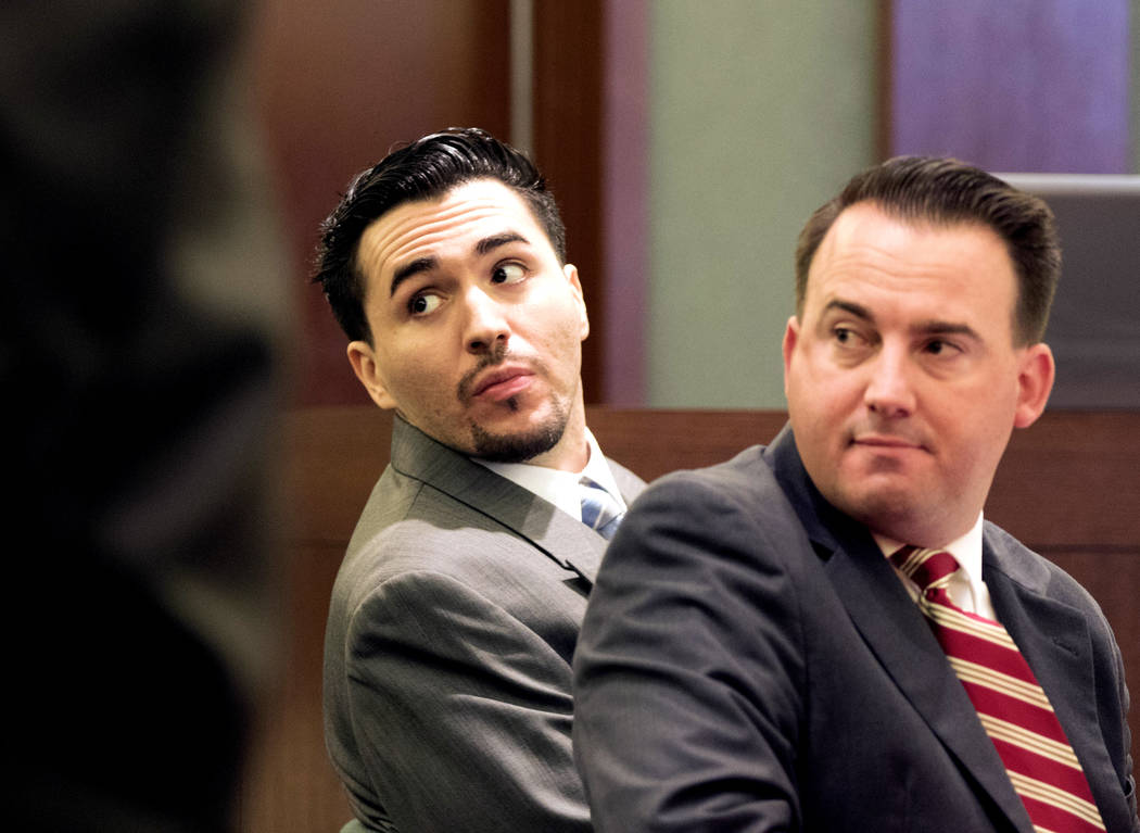 Javier Righetti, left, who is facing the death penalty for the rape and murder of 15-year-old Alyssa Otremba, looks back as the jury comes in to his trial with his defense attorney Ryan Bashor at  ...
