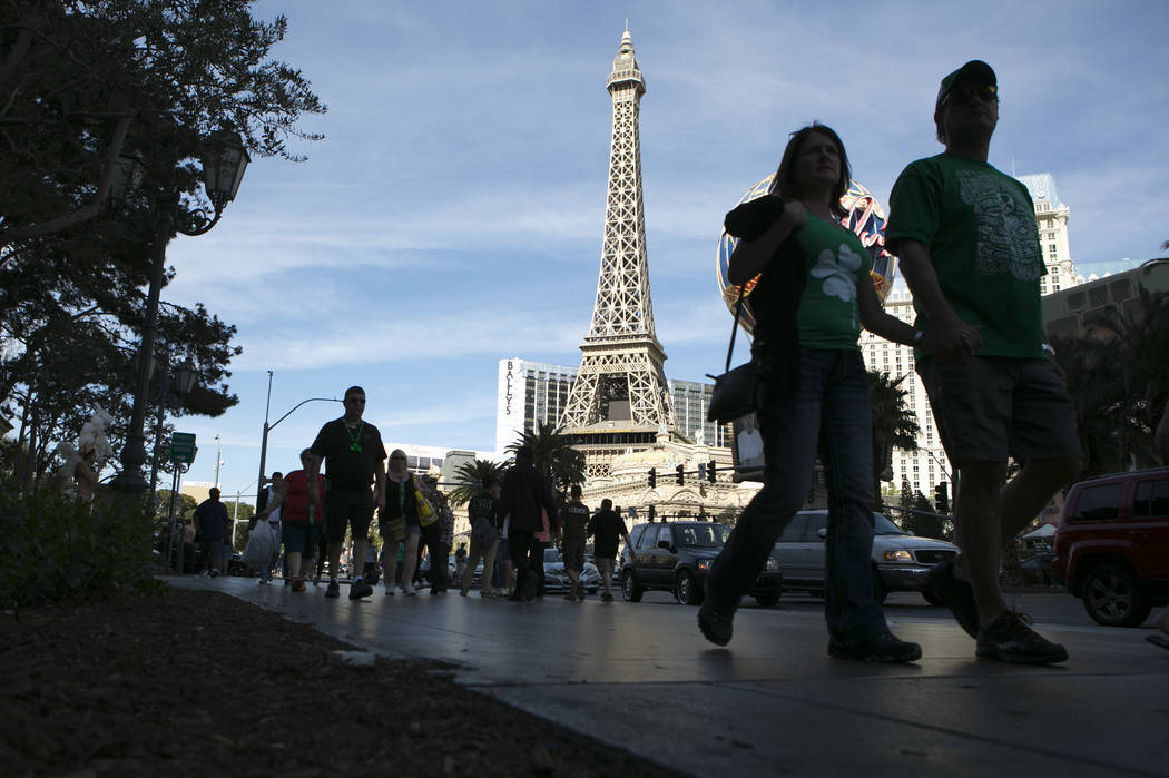 Pedestrians pass Paris Las Vegas' Eiffel Tower Experience on the Las Vegas Strip on Friday, March 17, 2017, in Las Vegas. (Bridget Bennett/Las Vegas Review-Journal) @bridgetkb