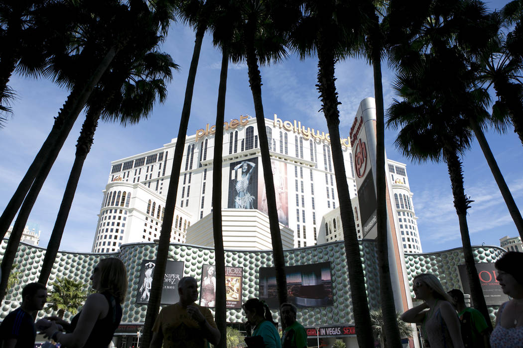 Pedestrians pass Planet Hollywood hotel-casino on the Las Vegas Strip on Friday, March 17, 2017, in Las Vegas. (Bridget Bennett/Las Vegas Review-Journal) @bridgetkb