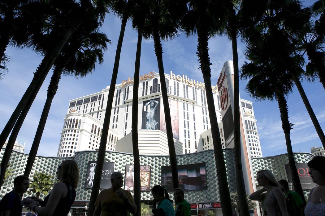 Pedestrians pass Planet Hollywood hotel-casino on the Las Vegas Strip on Friday, March 17, 2017, in Las Vegas. (Bridget Bennett/Las Vegas Review-Journal) @bridgetkb