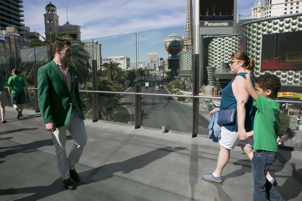Pedestrians pass on a walkway over Las Vegas Boulevard South at West Harmon Avenue on the Las Vegas Strip on Friday, March 17, 2017, in Las Vegas. (Bridget Bennett/Las Vegas Review-Journal) @bridgetkb