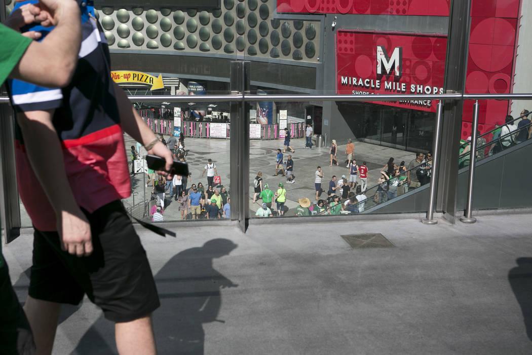Pedestrians pass on a walkway over Las Vegas Boulevard South at West Harmon Avenue on the Las Vegas Strip on Friday, March 17, 2017, in Las Vegas. (Bridget Bennett/Las Vegas Review-Journal) @bridgetkb