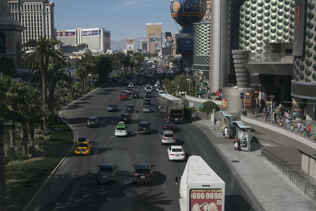 Crowds of pedestrians are seen bordering Las Vegas Boulevard South as seen from a walkway at West Harmon Avenue on the Las Vegas Strip on Friday, March 17, 2017, in Las Vegas. (Bridget Bennett/Las ...
