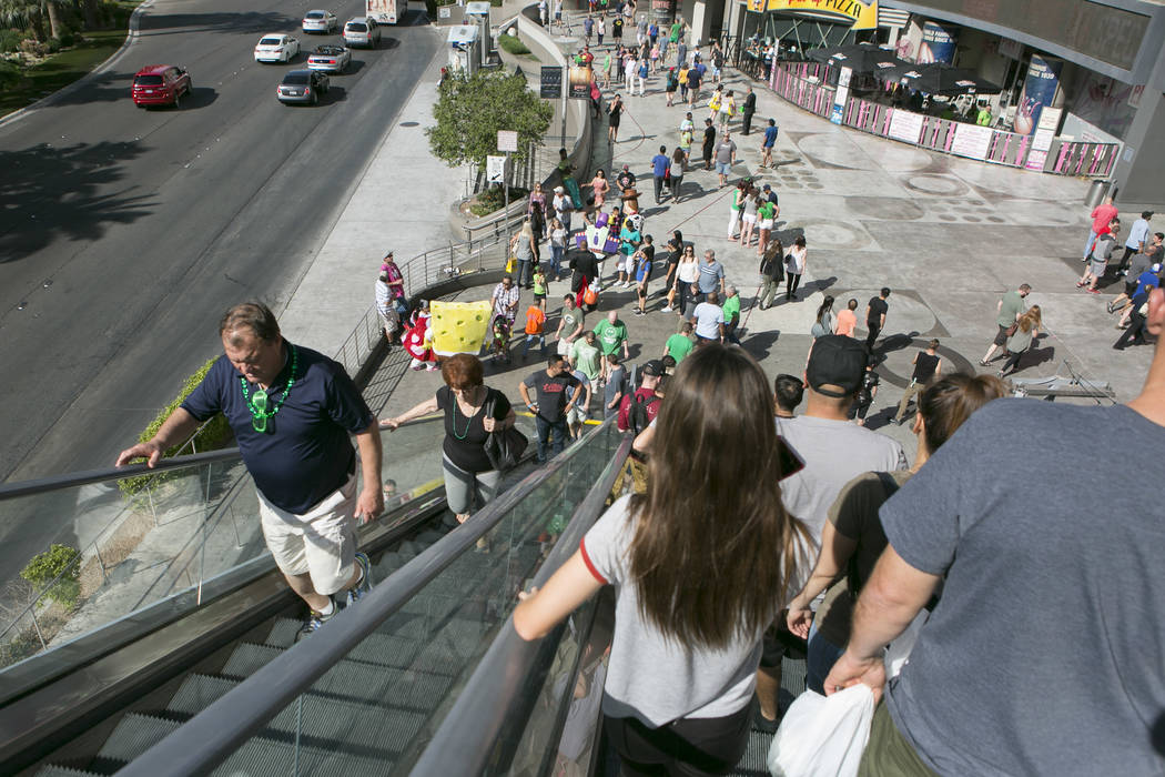 Pedestrians pass on an escalator near Las Vegas Boulevard South and West Harmon Avenue on the Las Vegas Strip on Friday, March 17, 2017, in Las Vegas. (Bridget Bennett/Las Vegas Review-Journal) @b ...